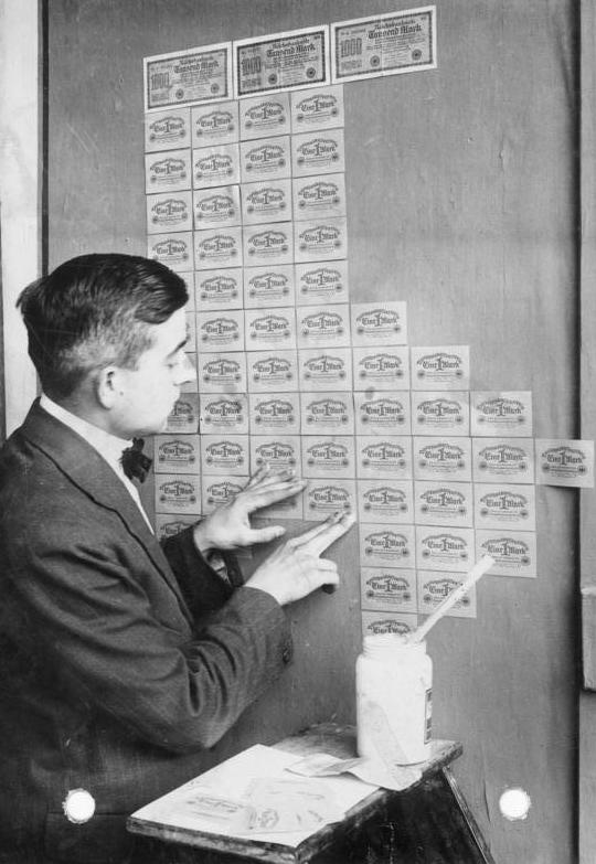 German kids playing with banknotes during the Weimar Republic hyperinflation